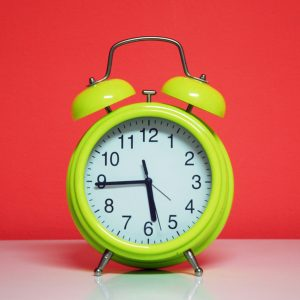 Alarm clock denoting 24 hour turnaround time