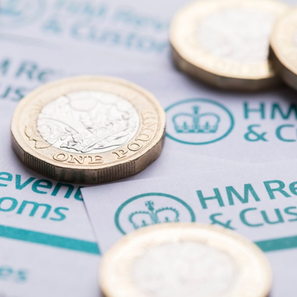 hmrc paperwork with pound coins scattered on top